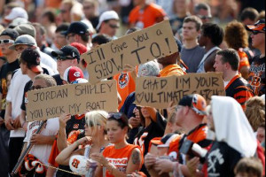 Bengals Fans Hold Signs...