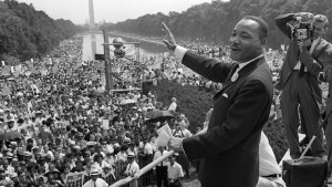 Civil rights leader Martin Luther King Jr. (C) waves to supporters ...