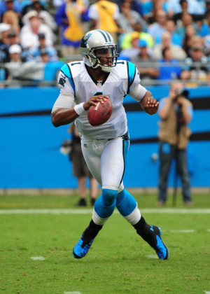 cam newton of the carolina panthers passes against the new orleans