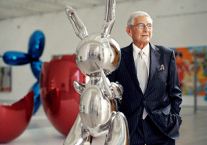 Eli Broad with a Jeff Koons sculpture...