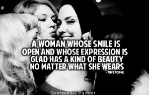 woman whose smile is open and whose expression is glad has a kind of ...