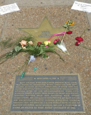 Flowers and handwritten quotes decorate Maya Angelou's Star on St ...