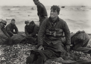... soldiers on Omaha Beach recover the dead after the D-Day invasion