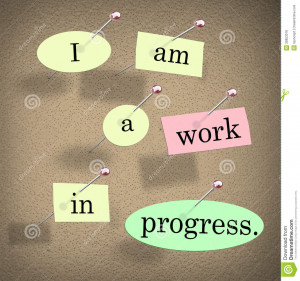 Am a Work in Progress quote or saying on pieces of paper pinned to a ...