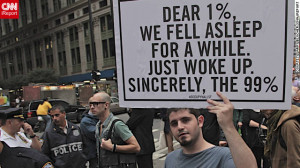 protester holds a sign at the Occupy Wall Street protest last ...