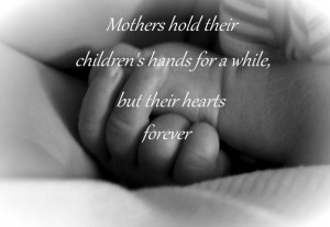 Mothers hold their children's hands