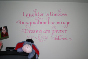 First, we spruced up the girls' room with this wall quote: