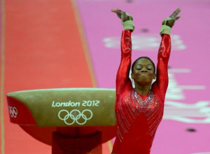 ... woman to win individual all-around gold and team gold at the Olympics