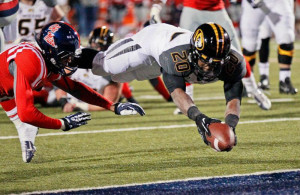 Missouri running back Henry Josey (20) dives into the end zone for a ...