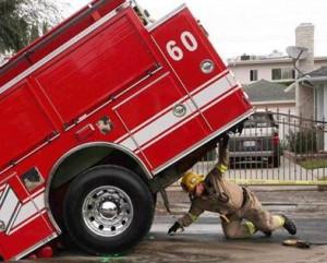 Super Hero Firefighter? NBC News Caption Said Fireman Holds Up a Fire ...