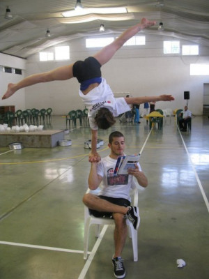 gymnastics Reading handstand just casually one arm acrobatic ...