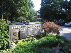 Main entrance to HKNC with Helen Keller quote - While they were saying ...