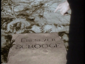 our papers come shows ebenezer scrooges headstone is still be