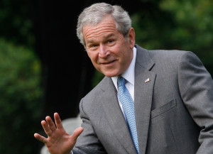 AP President Bush, waving as he leaves the White House on Friday for a ...