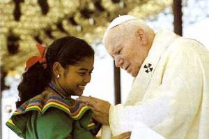 John Paul II caressing the chin of a young woman