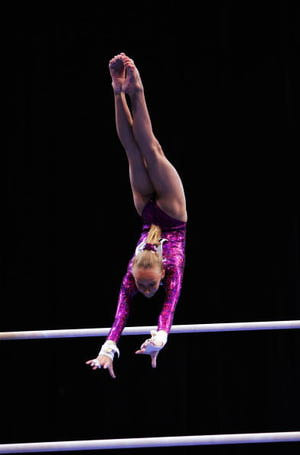 Gymnast Nastia Liukin does a Pak salto on bars at the 2004 Nationals ...