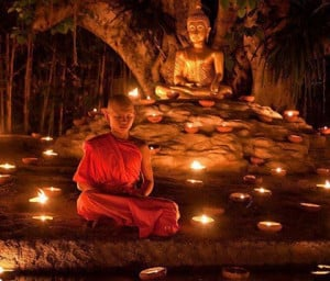 Beautifully Meditating Little Monk Before Lord Buddha in Night Lamp