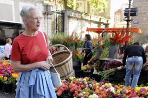 Queen Margrethe II of Denmark walks along the market of Caix-Luzech ...