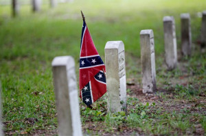 confederate flag is seen at a tombstone on the cemetery at Beauvoir ...