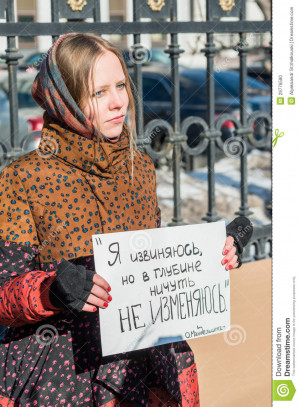 , RUSSIA - 8 MARCH: Russian activist holds placard quotes Russian ...