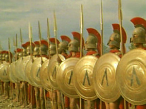 Left: Spartan hoplites in formation. Spartans marked their shields ...