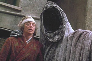 The Ghost of Christmas Yet to Come, with Ebenezer Scrooge
