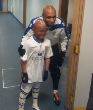 Hero: The child posed with El Hadji Diouf in the tunnel at Elland Road ...