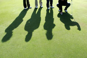 Golfers on the golf pitch. - Jochen Tack/ arabianEye/ Getty Images