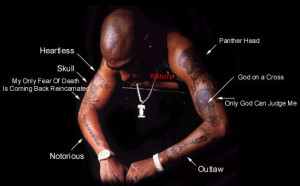 2pac's arm tattoos.