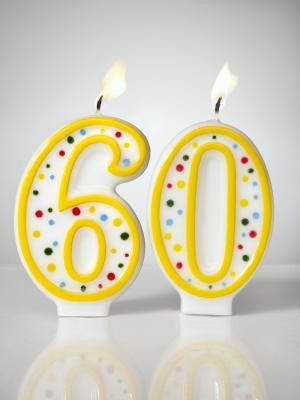 numbered birthday candles aflame shot on white background - Jana Leon ...