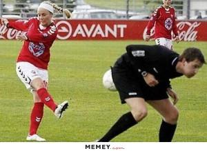 Girl Kicking A Ball At The Referee