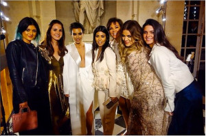 by sisters Kourtney, Khloe, Kylie, Kendall and her mother Kris Jenner ...