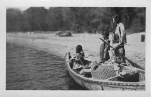 Ojibwa Indian women on a canoe.