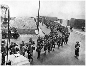 American soldiers march through a British town to their embarkation ...