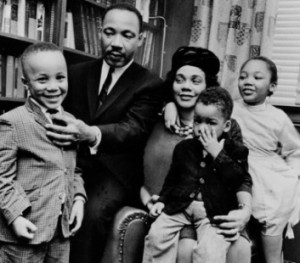 Dr. Martin Luther King Jr. and his wife, Coretta Scott King, sit with ...