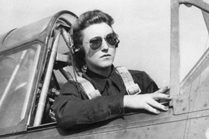 Women's Airforce Service Pilot (WASP) sits in the cockpit of her ...