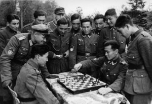 ... of the Wehrmacht, play chess in this staged photo. Normandy, 1943