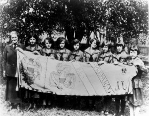 Juliette Gordon Low stands with a group of Girl Scouts in 1924, three ...