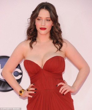 Kat Dennings shows some major cleavage at the Emmy's