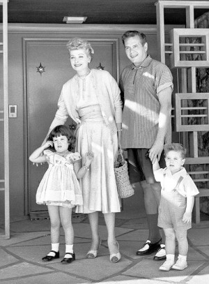 Lucille Ball and Desi Arnaz photographed outside their home with their ...