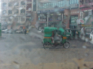 Motorcycle taxi in Dhaka Bangladesh in the pouring rain. So much for ...