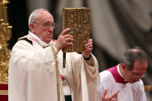 gospel as he attends the Holy Saturday Easter vigil mass at St. Peter ...