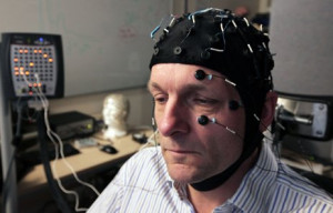 Michael Mosley with an electroencephalograph cap on to measure his ...