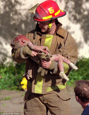 Sheltered in my arms: Oklahoma City fire Captain Chris Fields carries ...