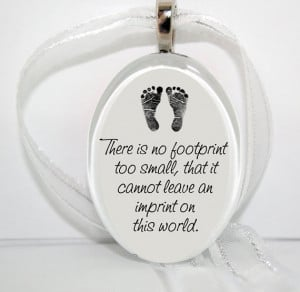 No footprint too small... Oval Glass Christmas Ornament