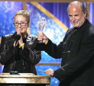 Spiderman 2' producers Laura Ziskin (L) and Avi Arad accept the award ...