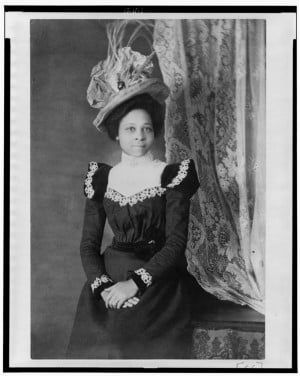Young African American woman, three-quarter length portrait, facing ...