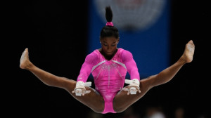 Simone Biles performs on the uneven bars during the women's all-around ...