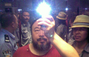 photo Ai Weiwei tweeted of his crew with police in an elevator in ...