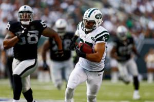 Lamarr Woodley Eric Decker 87 of the New York Jets runs after a catch